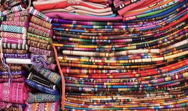 Colorful blankets on display in Otavalo Market in Ecuador