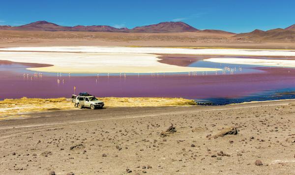 Red lagoon, salar de Uyuni Bolivia with Pie Experiences